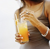 Woman holding cocktail (Thailand)