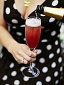 Woman holding glass of sparkling wine