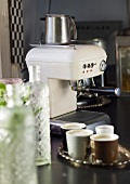Espresso machine and several espresso cups