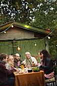 Family eating in an autumn garden