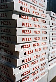 Lots of pizza boxes, stacked