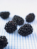 Blackberries on checked fabric