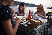 Scandinavian family eating on holiday in Greece