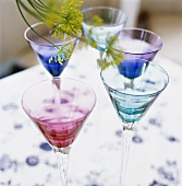 Pink and blue wine glasses on table