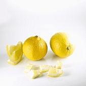Two lemons and pieces of lemon