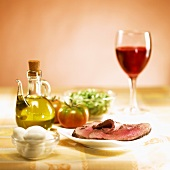 Steak with salad ingredients and wine