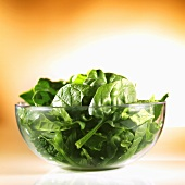Spinach leaves in a glass bowl