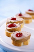 Canapés: pâté, cranberry jelly & rosemary on baguette slices