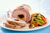 Ham stuffed with prunes, vegetable salad