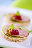 Salami, cucumber, cranberry jam and mustard on wholemeal bread
