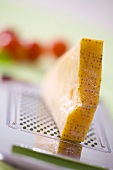 A piece of Parmesan on a grater