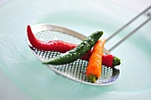 Mixed Thai chillies on a skimmer