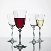 Glass of red wine, glass of white wine & empty wine glasses