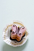 Petit four (butterfly) in paper case