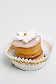 Petit four with sugar flower in paper case