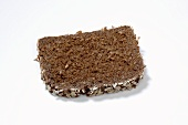 A slice of Finnenbrot (wholegrain bread with seeds)