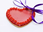 Red heart-shaped biscuit with bow