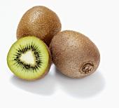 Kiwi fruits and half a kiwi fruit