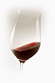 Red wine swirling in glass
