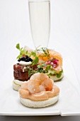 Assorted canapés and glass of sparkling wine