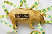 Golden pig with bow for New Year (good luck charm)