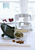 Tea infuser full of tea, teapot