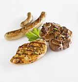 Grilled chicken breast, steak and sausage