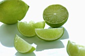 Limes, whole, halved and sliced