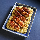Barbecue Bacon Wrapped Chicken Tenders on a Bed of Rice