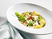 Pasta with prosciutto, champignons and Parmesan