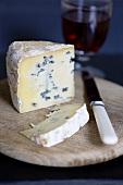 A piece of blue cheese (type: Mrs Temple's Binham Blue, Norfolk, UK)