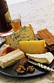Cheese platter with nuts, crispbread, raw ham and wine