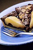 Chocolate and pear tart with slivered almonds
