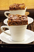 Caramel slices on coffee cups