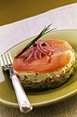 An open sandwich with herb butter and smoked salmon