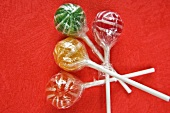 Four coloured lollipops in cellophane paper