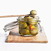 Green olives in preserving jar