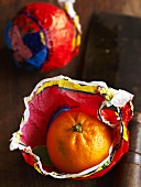 Blood oranges with wrapping paper