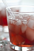 Campari with ice cubes