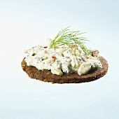 Quark with vegetables and herbs on whole grain bread