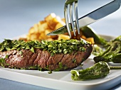 Steak coated in herbs with Pimientos de Padron