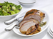 Stuffed breast of veal with salad leaves