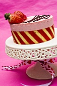 Strawberry charlotte on cake stand