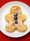 Pancake-Männchen mit Heidelbeeren und Ahornsirup
