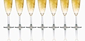 Glasses of sparkling wine in a row