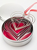 Heart-shaped cutters and hanger with ribbon