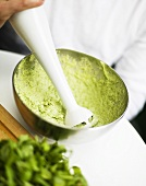 Making pesto with an immersion blender