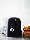 Toaster with slices of bread next to it