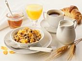 Breakfast: muesli, honey, orange juice, coffee & croissant