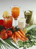 Still life with vegetable juices, vegetables and herbs